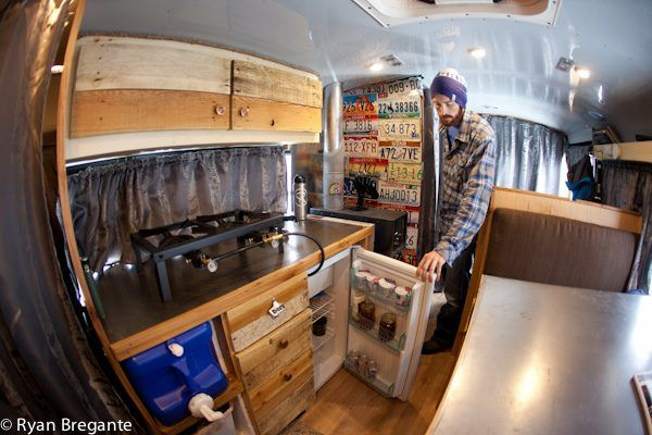 man living in converted school bus