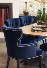 Crushed velvet royal blue dining chairs and wood table ...