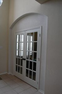 Enclosed archway and installed french doors to create a ...