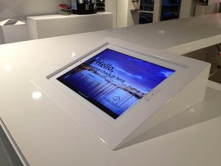 iPad kiosk integrated in reception desk  Proxyclick