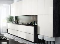 Modern IKEA kitchen with black brown cabinets, high gloss
