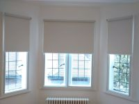 Blackout roller blinds fitted to a bay window | First Home ...