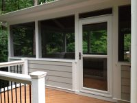 Screen porch with side deck and Larson storm door ...