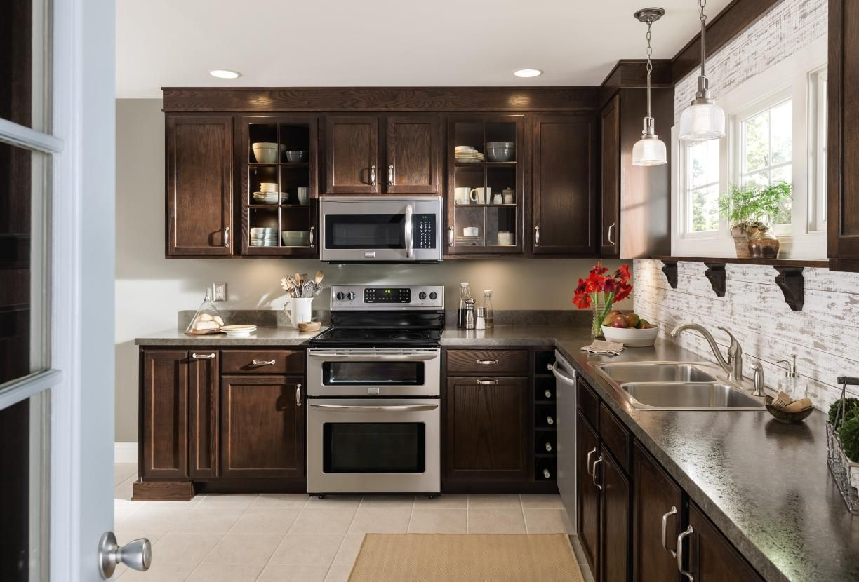 aristokraft kitchen cabinets portable island with granite top paired the rich deep beauty of our umber finish