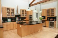 Modern Kitchen with Dark Granite and Light Maple Cabinets ...
