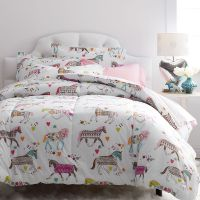 Super-cozy kids comforter, designed with a colorful ...