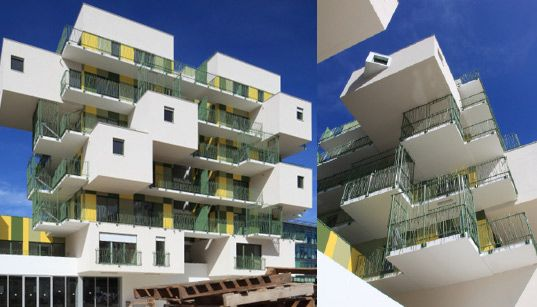 KOZ Completes 28 Green Literally And Yellow Stacked Apartments