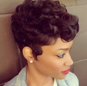 short curly haircut with wavy sideburns