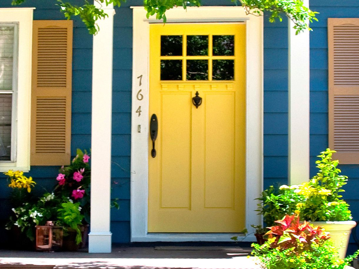 Cheerful Blue House Exterior Paint Idea With Yellow Door White