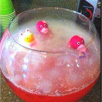 Pink punch for baby shower with dry ice and rubber duckies