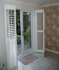 Patio Door Shutters. These plantation shutters are of the ...