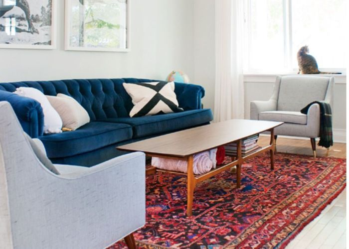 Persian rug tufted blue velvet sofa mid century chairs in sunbrella fabric neutral walls also navy and color combo anna ryan house pinterest