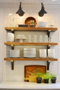 White farmhouse kitchen, open shelving, subway tile