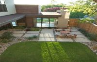Large concrete patio pavers with river rock in between ...