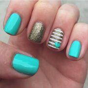 tiffany blue nails with gold accents