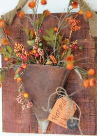 LOVE this rusty oil funnel turned front door wreath ...