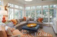 Gray and orange living room features walls of undressed ...