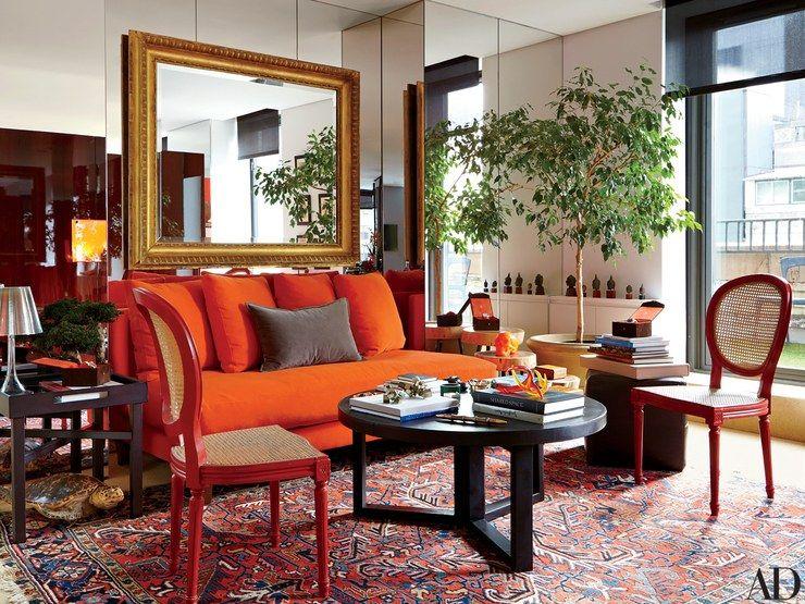 Jewelry designer james taffin de givenchy   vibrant manhattan showroom red accentsarchitectural digestdesign trendsliving room also rh pinterest