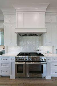 custom range hood in white kitchen | Mahshie Custom Homes ...