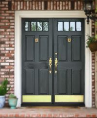 Black front door with Brass Lion door knockers, door ...