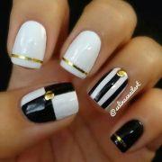black white and gold nail design