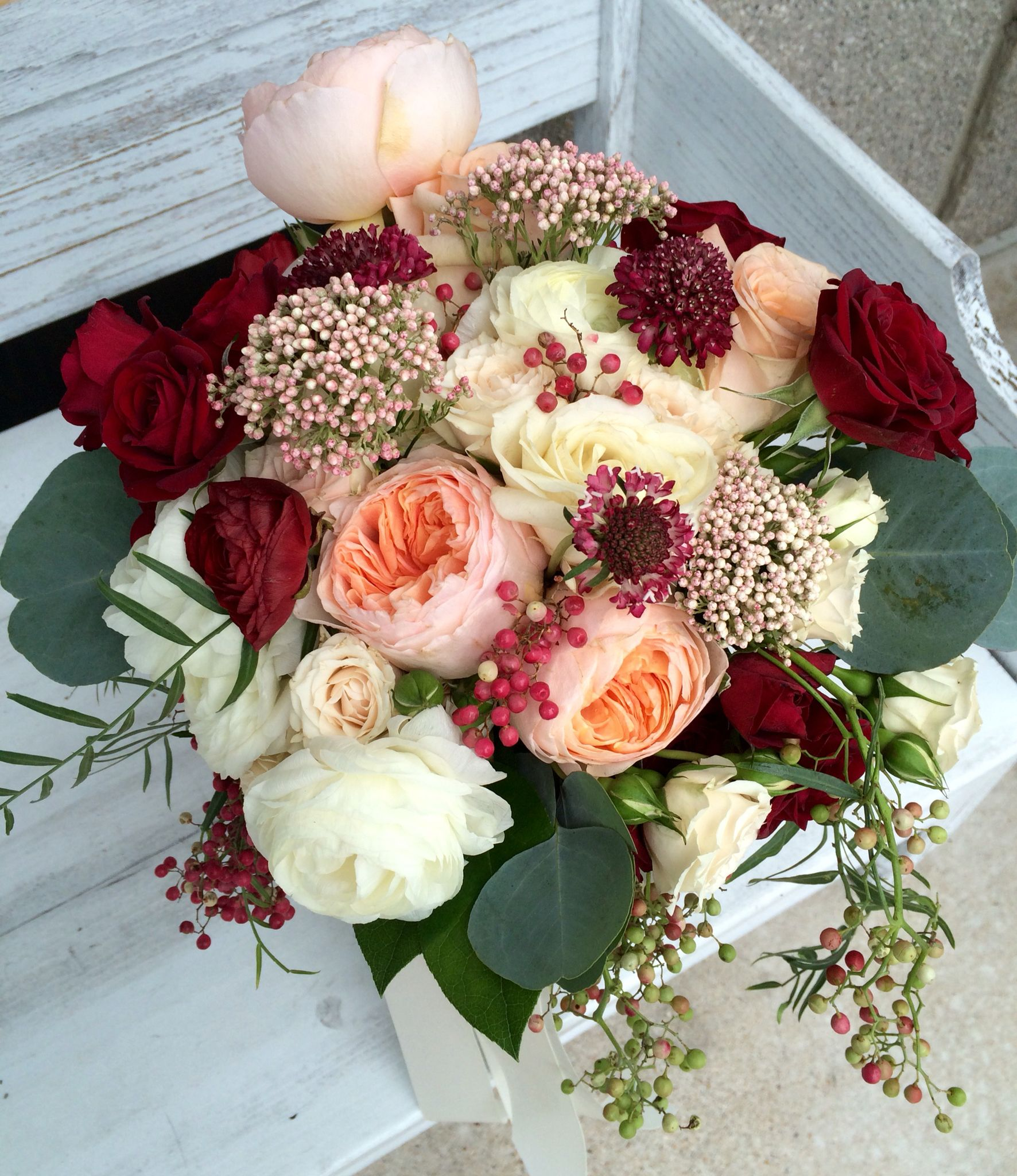 Bridal bouquet featuring blush garden roses ivory and
