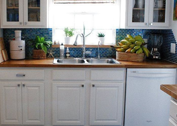 Butcher block counter tops in blue and white kitchen cabinets backsplash also