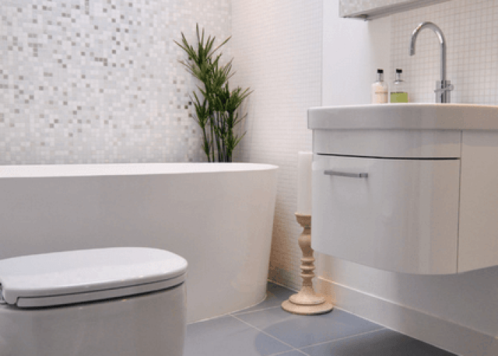 Everything but the oversized tile flooring bathroom with crystal glass and suspended sink unit overhead mirrored cabinet also different floor shower  light colored uses
