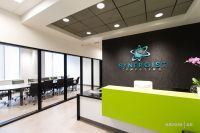 Office reception area with custom reception desk, green ...