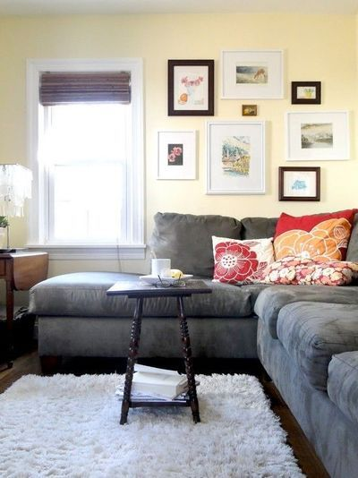 tan leather sofa decor cheap corner sofas on ebay gray couch, dark floors, light rug, walls, red and ...
