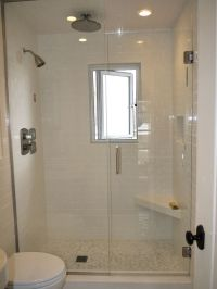 small walk in shower with window. small grip bar and foot ...
