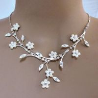 Faux pearl white flowers adorn elaborate rhinestone ...