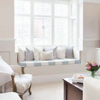 Cream living room with window seat | White shutters ...