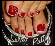 red toenail with white flowers