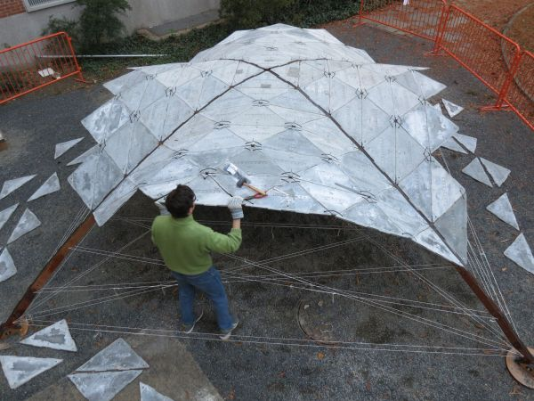 Thin shell segmented dome built with precast tiles Design