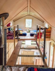 Tiny houses also upstairs you  ll see something very unusual two lofts connected by  rh pinterest