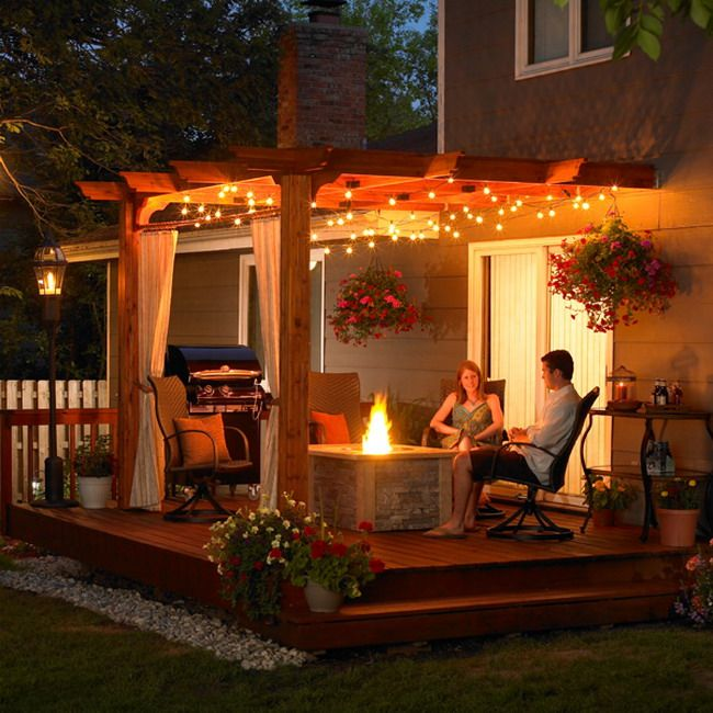 Outdoor Patio Ideas with Wooden Cover and Modern Lighting