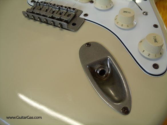 Vintage stone logo Fernandes Strat copy metal hardware with some nice patina on the jack socket and bridge.