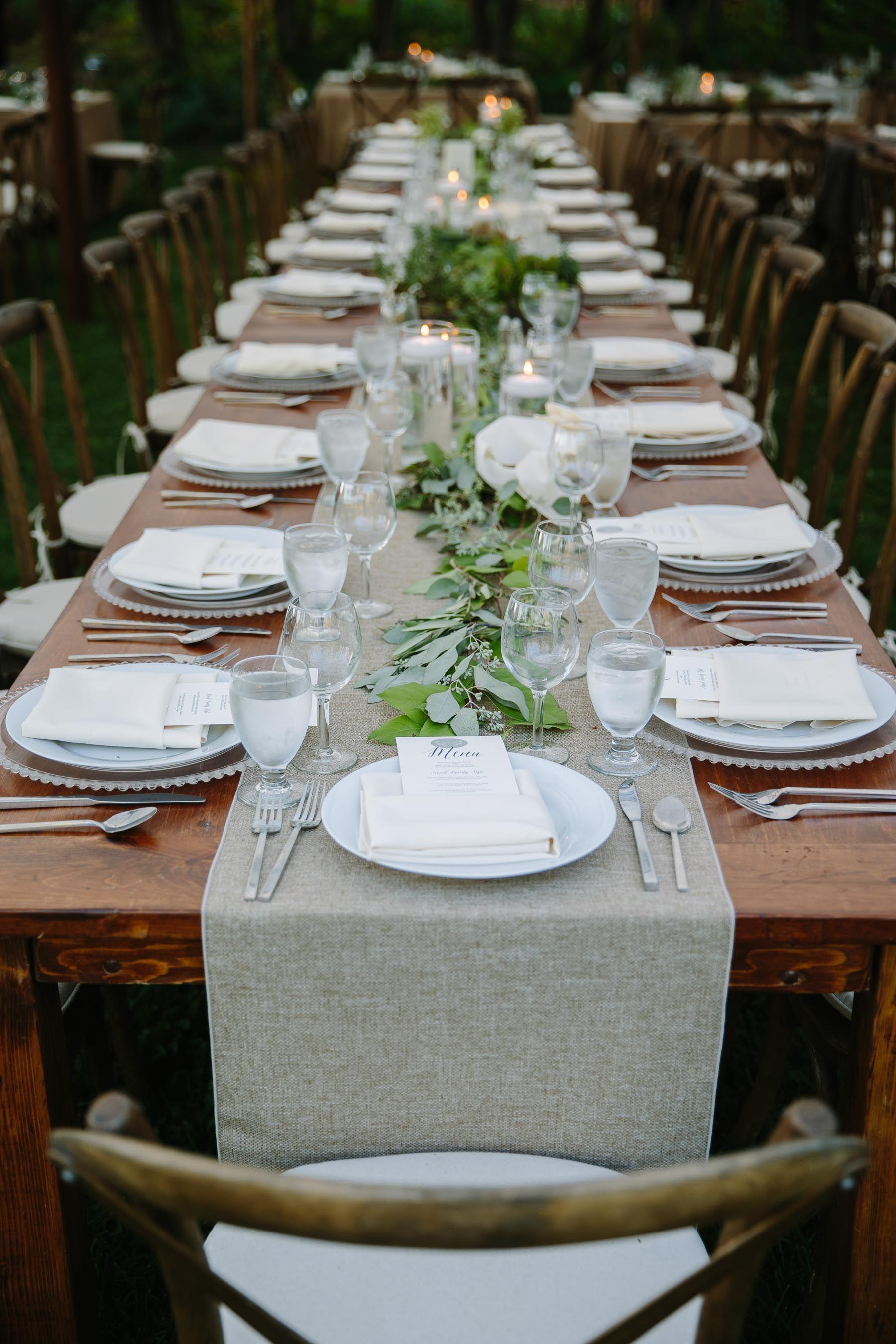 elegant table settings at a wood table at Brookwood