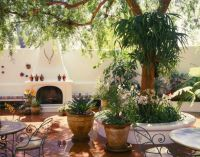 Lush Spanish style patio with saltillo tile floor and ...