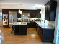 Kitchen with espresso stained cherry cabinets, granite ...
