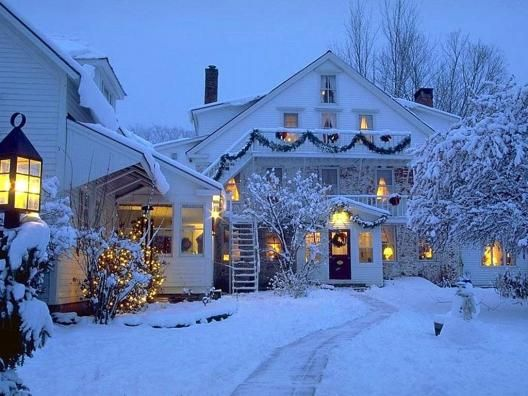 christmas decorated houses covered with snow