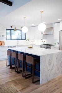 A kitchen reveal for a mid-century modern remodel. White ...