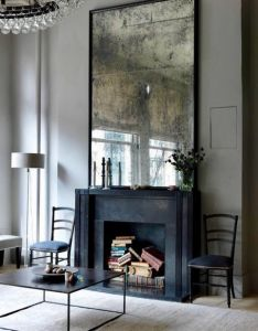 solutions for  non working fireplace piled up vintage books in stunning moody room by erin swift also personne house inspiration pinterest mantle mirror interiors rh