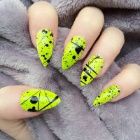 Neon yellow and black splatter Stiletto Nails