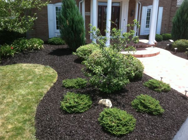 dark brown rubber mulch in commercial