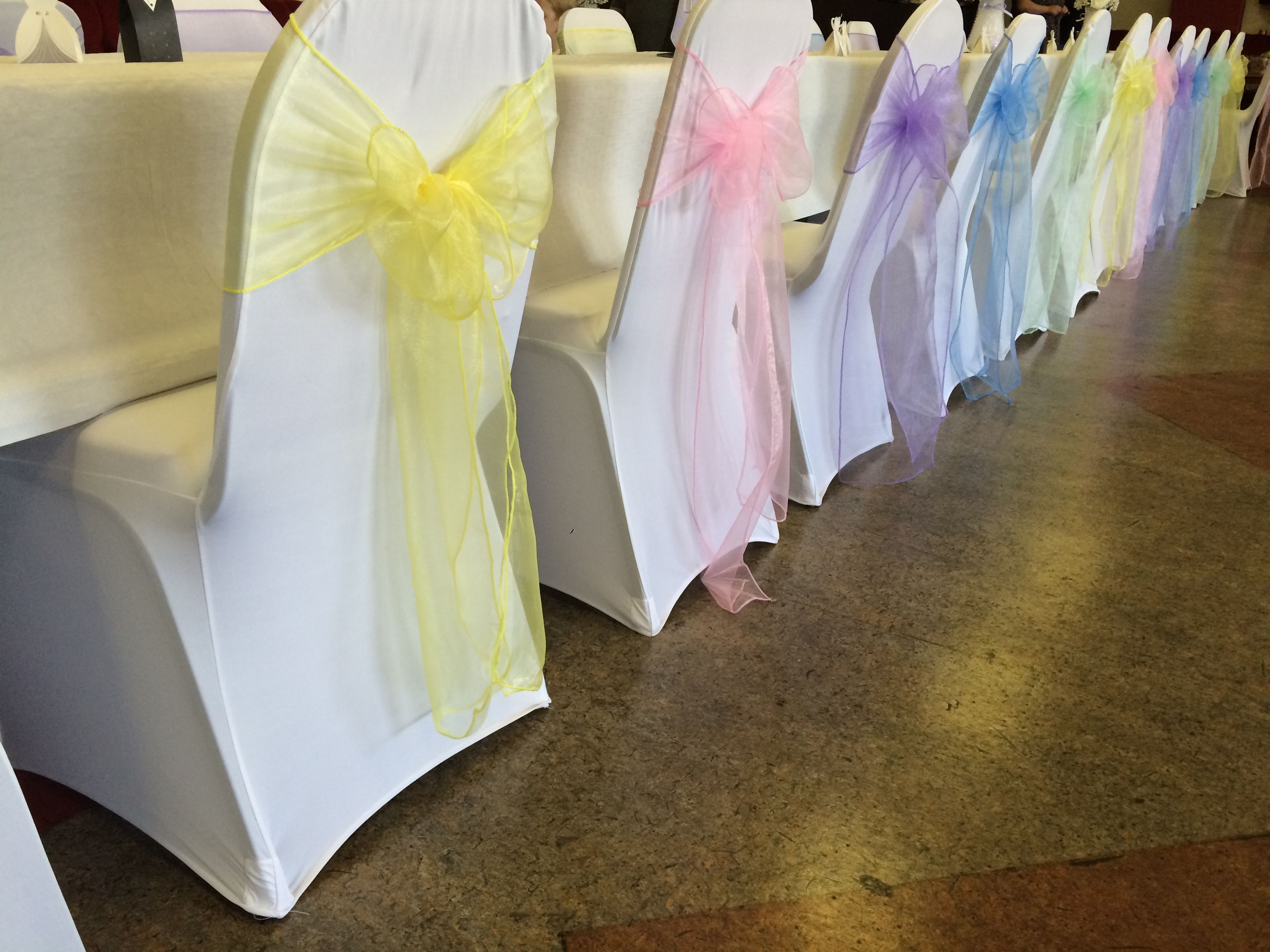 chair covers for hire south wales tall accent chairs white with pastel multicoloured organza