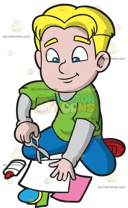 A Boy Cutting Colored Sheets For His Scrapbook Boy Cuts