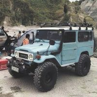 Light Blue Toyota Land Cruiser BJ44 on Beach with Snorkel