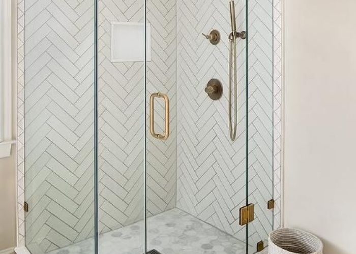 Master bathroom shower with white herringbone tiles and gray grout features perfect dimensional patterns also fi